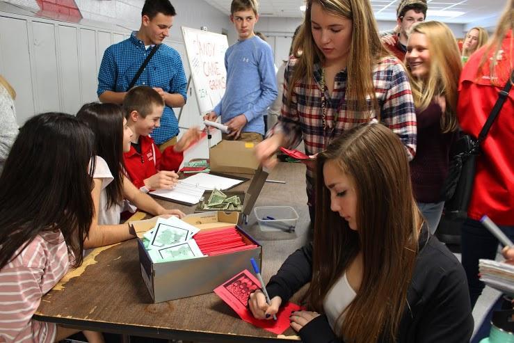 Senior Jenny Tourville fills out a candy cane gram, raising money for the freshman class council.