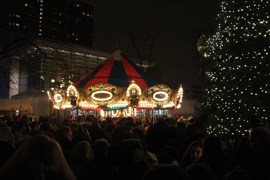 The village's carousel revolves around a Christmas tree.