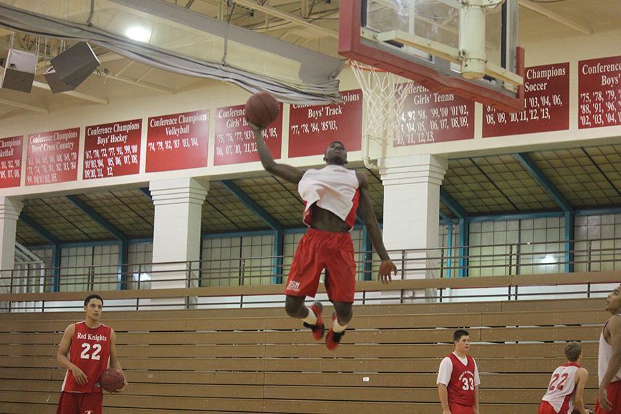 Senior Jalen Floyd dunks the ball during a practice.
