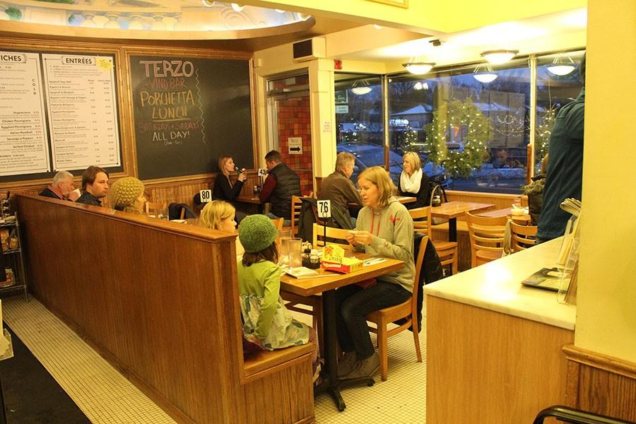 Although the restaurant is primarily set up for take-out or delivery, there are about ten small tables for seating.