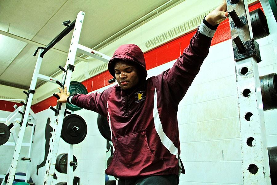 Wrestler Jameer Anderson sweats through his layers of clothing as he tries to shed some weight.
