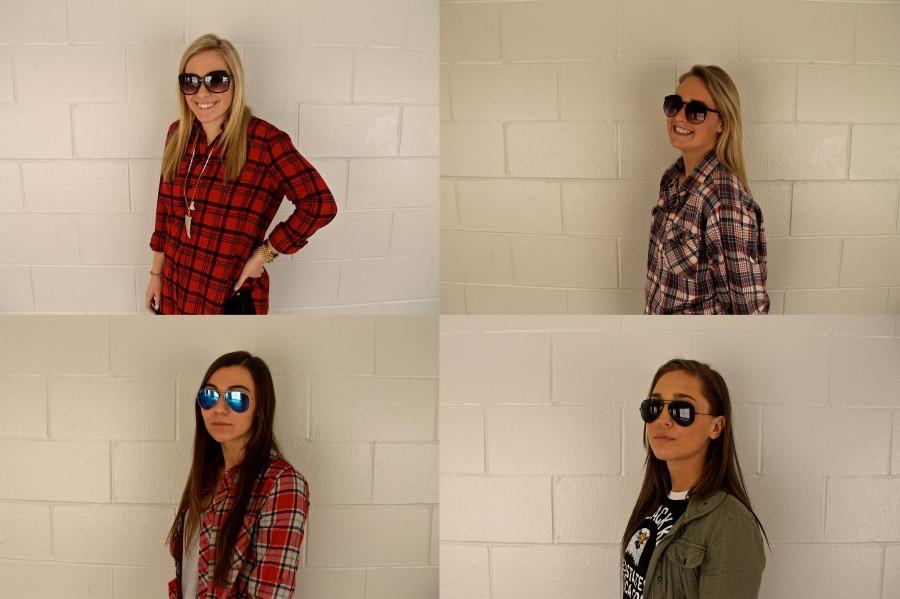 Senior+girls+show+off+their+sunglasses+for+spring+break.+