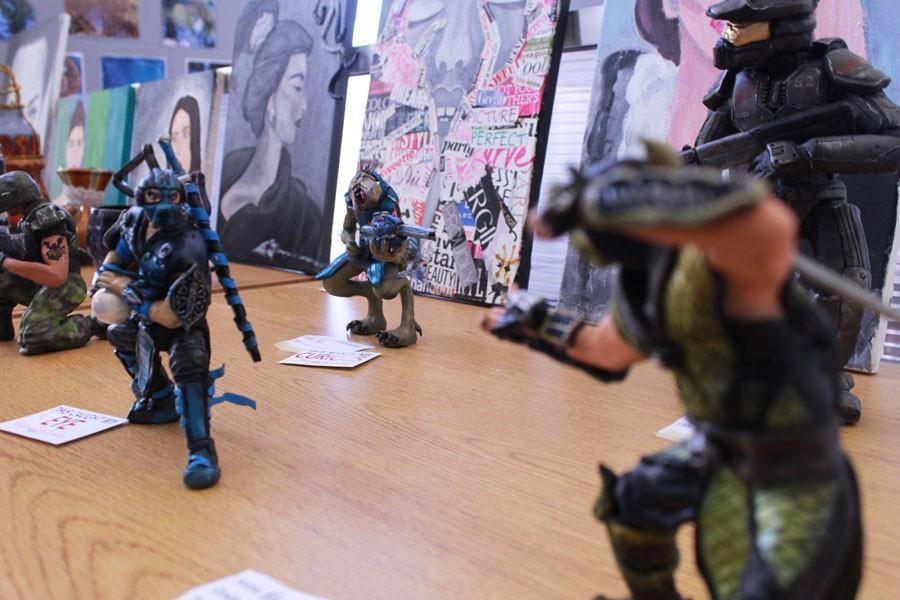 Matt+Bonvino%27s+clay+statuettes+displayed+in+mock+battle+at+the+BSM+Art+Fair.