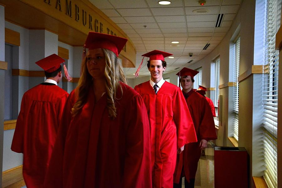 Graduates gathered in the theater before processing into the Haben Center together.