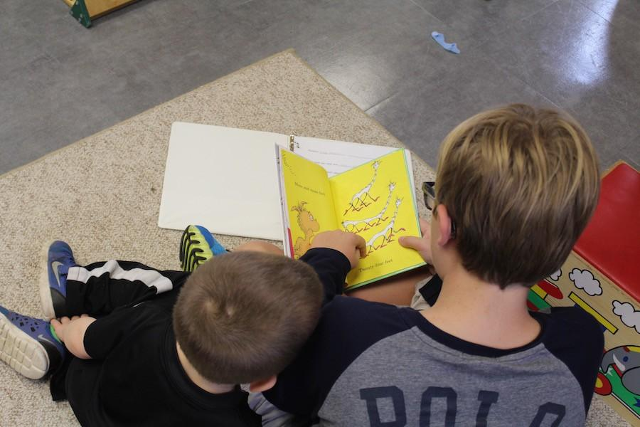 The freshmen reading buddies meet with the Little Knights on Monday and Friday mornings.