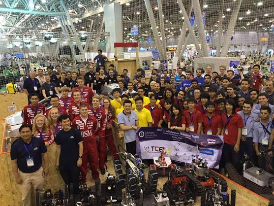 BSM graduates pose with their competitors and bot at the 2015 robocup in Hefei, China.