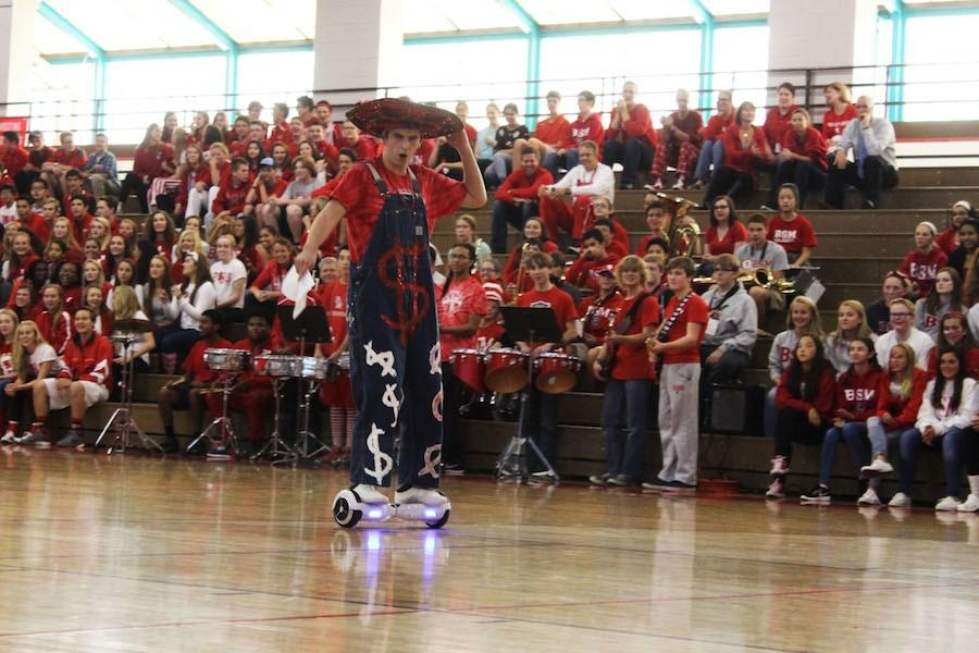 Senior Peter McCague was the MC of the Homecoming Pep Fest and featured his own pair of decorated senior overalls.