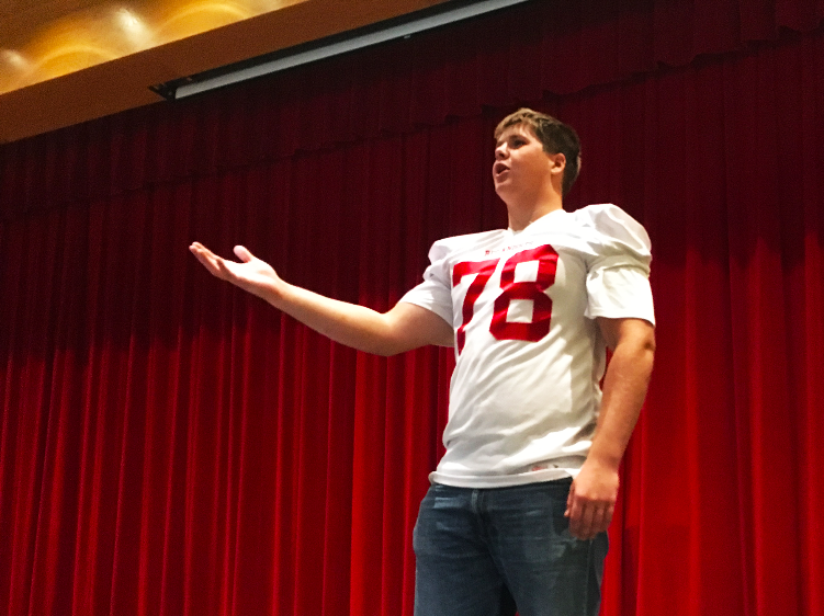On the football field, Wilson switches between right guard and right tackle but, in the choir, he is a baritone.
