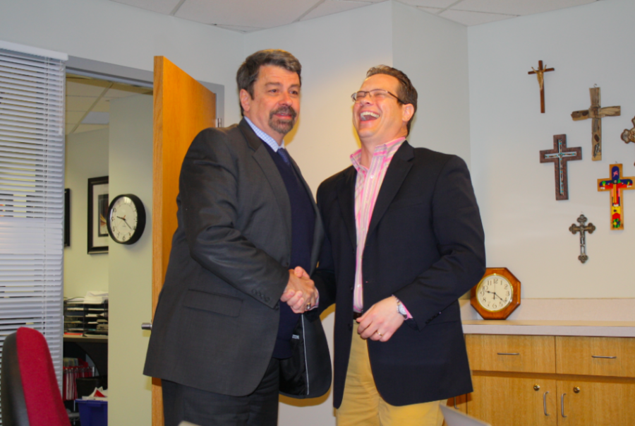 Dr. Gyolai laughs as he meets with Dr. Tift, the former president of BSM.
