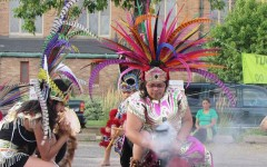 Alma Godinez participates in an Aztec-style dance group