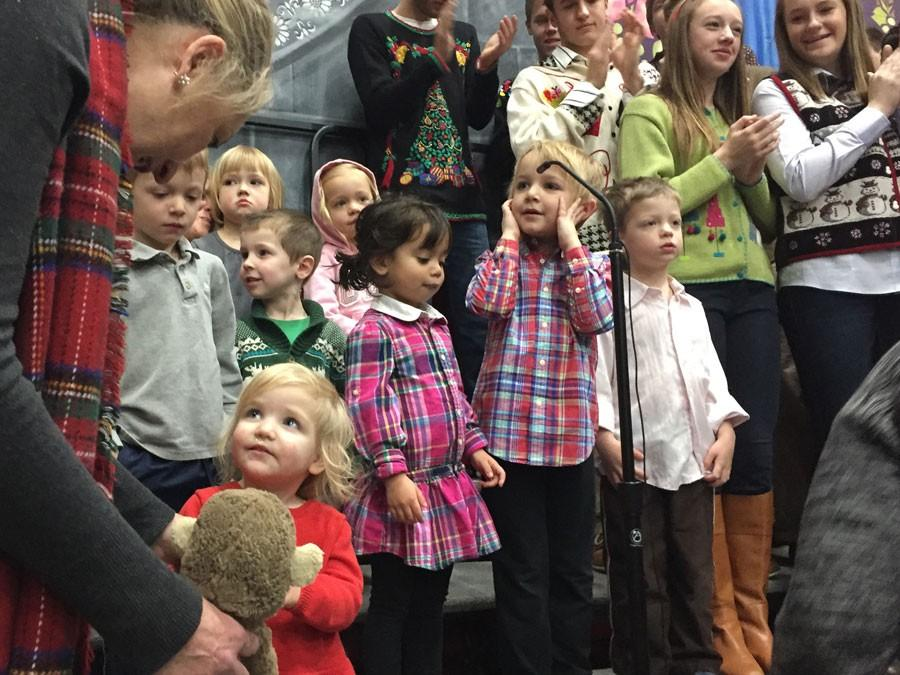 The+Little+Knights+performed+two+different+Christmas+songs+to+kick-off+the+after-liturgy+celebration.