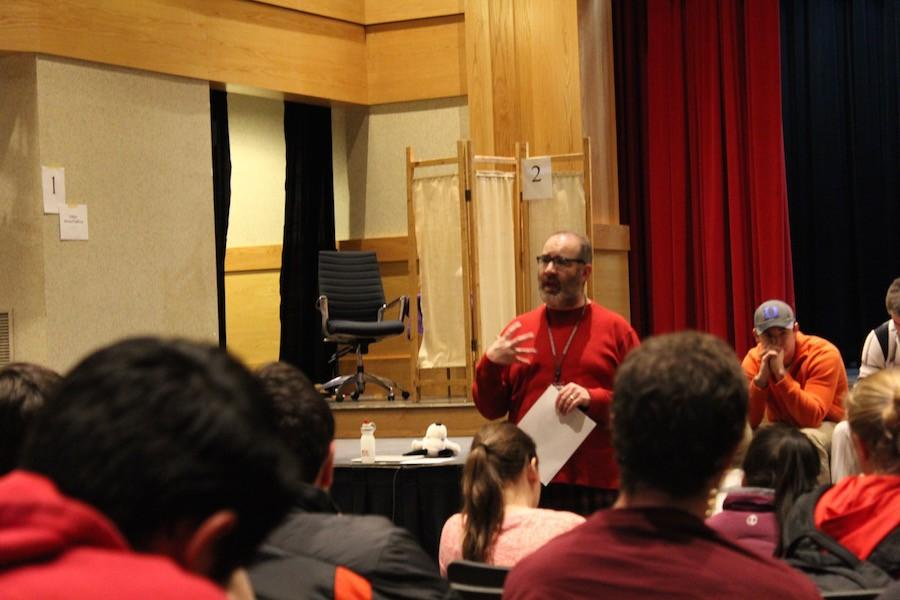 Trip director Mr. Robert Epler gives information to students interested in the Italy spring break trip.