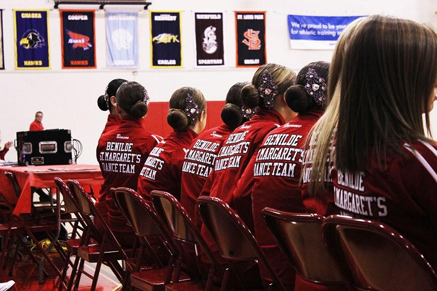 The dance team prepares for the first meet with their managers.
