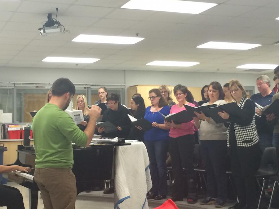 Choir leader Mr. Adam Petroski prepares the community choir for the concert.