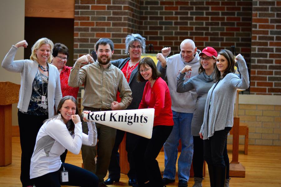BSM faculty and staff took a photo in suport of Dickey using the hashtag #flexforann.