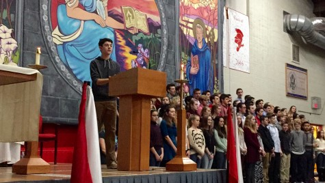 Performing his song with the accompaniment of the choir and the piano, Matt Hansberry premiered his original song at mass.