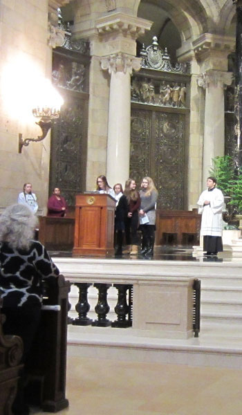 Ava Lundberg and Emma Paquette read at the March for Life Mass.