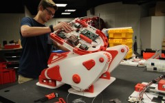 Engineering III student, Bryan Johnson, works on the robot the team will take to Germany.