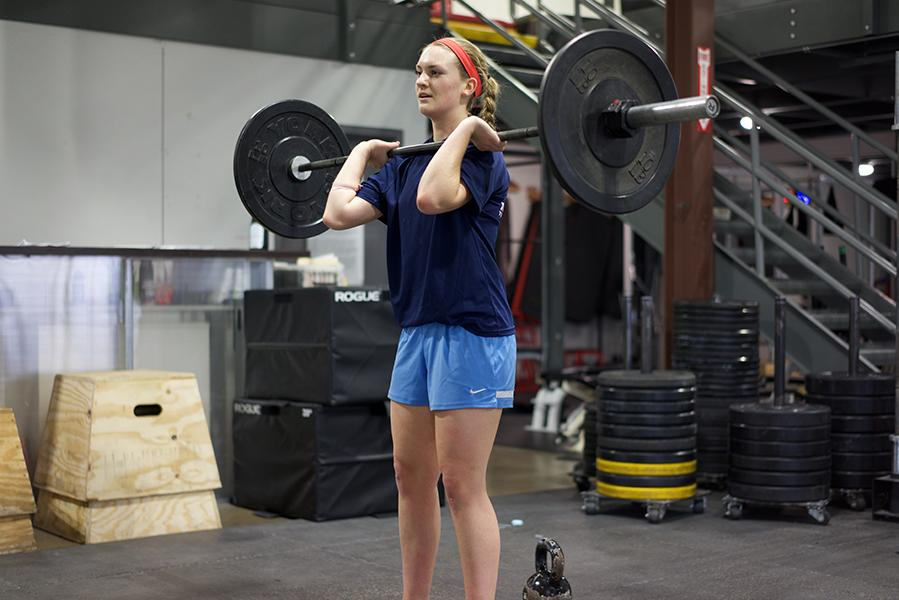 Lifting+weights+is+a+part+of+Lauren+Gustafson%27s+rigorous+training+for+increasing+her+fitness.
