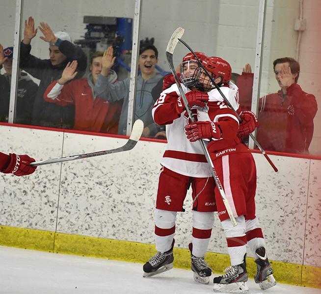 Moore and Risteau share a celebratory embrace after a score.