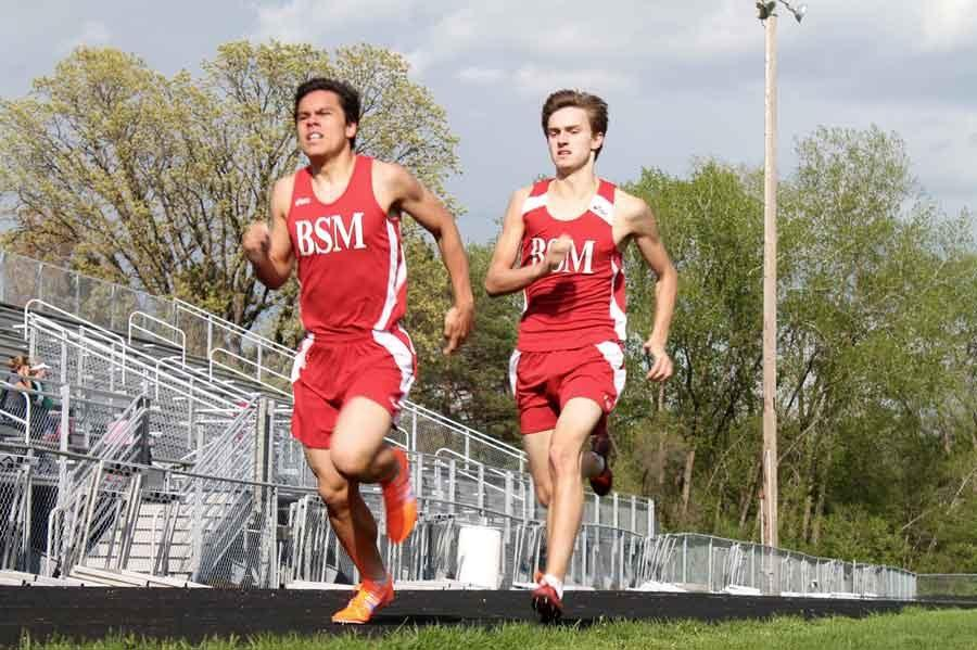 Sophomore Lorenzo Cerda and senior Henri Schmidt racing to the finish in the mile.