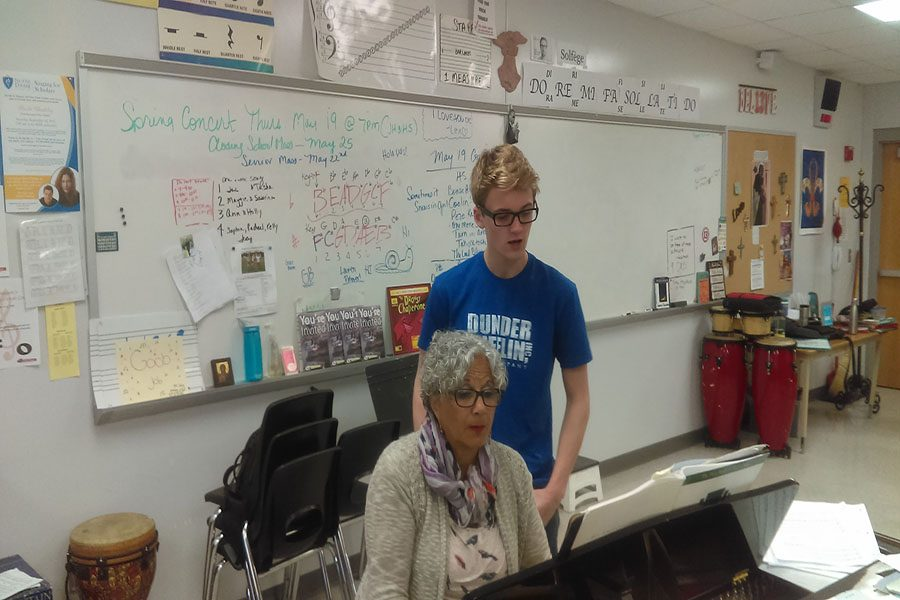 Practicing with choir teacher Nancy Stockhaus, Junior Carson Knoer sings proudly knowing that he made it into the top 10 for the Spotlight Triple Threat Award.