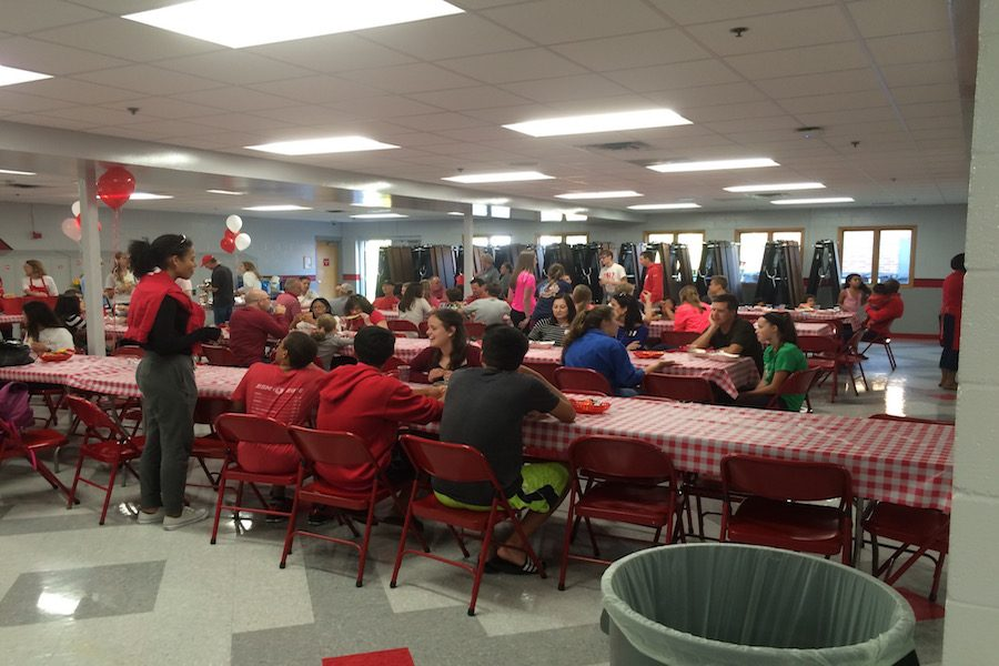 Freshmen and Link Crew leaders enjoy the cookout before the football game against Irondale.