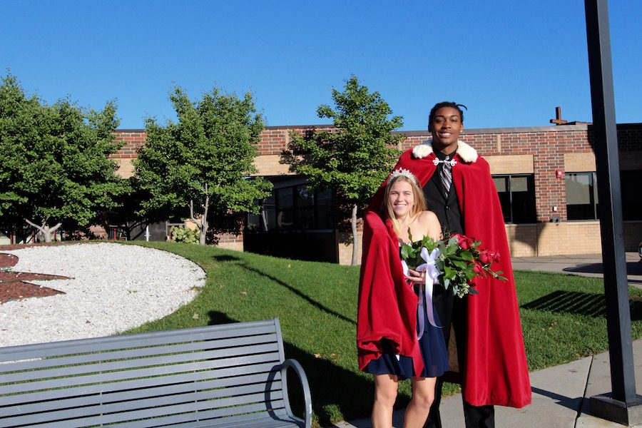 Homecoming+king+and+queen%2C+seniors+Malachi+Johnson+and+Claudia+Elsenbast%2C+stand+outside+BSM+after+coronation.