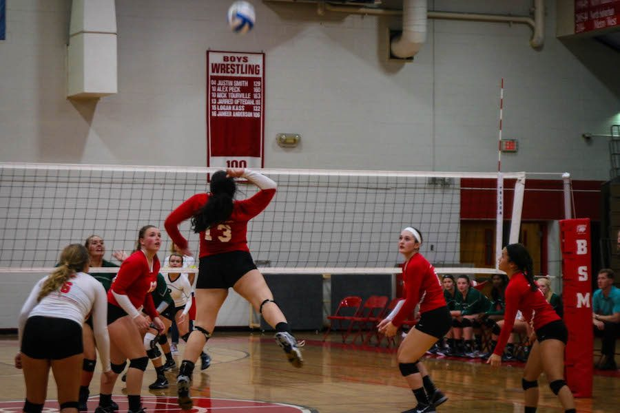 Junior+Alyssa+Brinza+gets+ready+to+spike+the+ball+in+search+of+a+point+against+Holy+Family+Catholic.