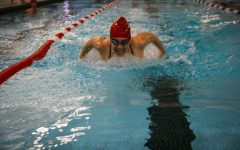 A swimmer works on her butterfly during one of 5-6 required practices each week.