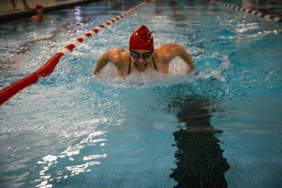 A+swimmer+works+on+her+butterfly+during+one+of+5-6+required+practices+each+week.