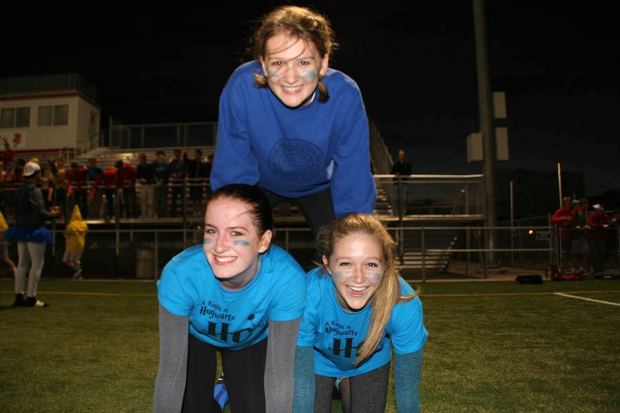 Juniors form a human pyramid cheering their team to victory during the powderpuff game.