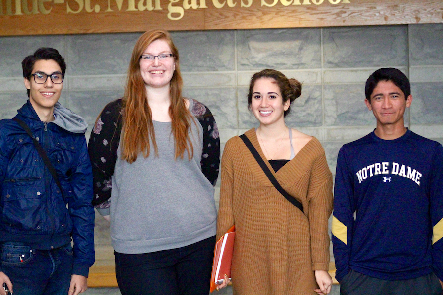Seniors Elier Meraz-Barrera, Teagan Wolf, Alexia Saavedra and Carlos McMerty-Brummer are four of the eight interns in the SLIP program.