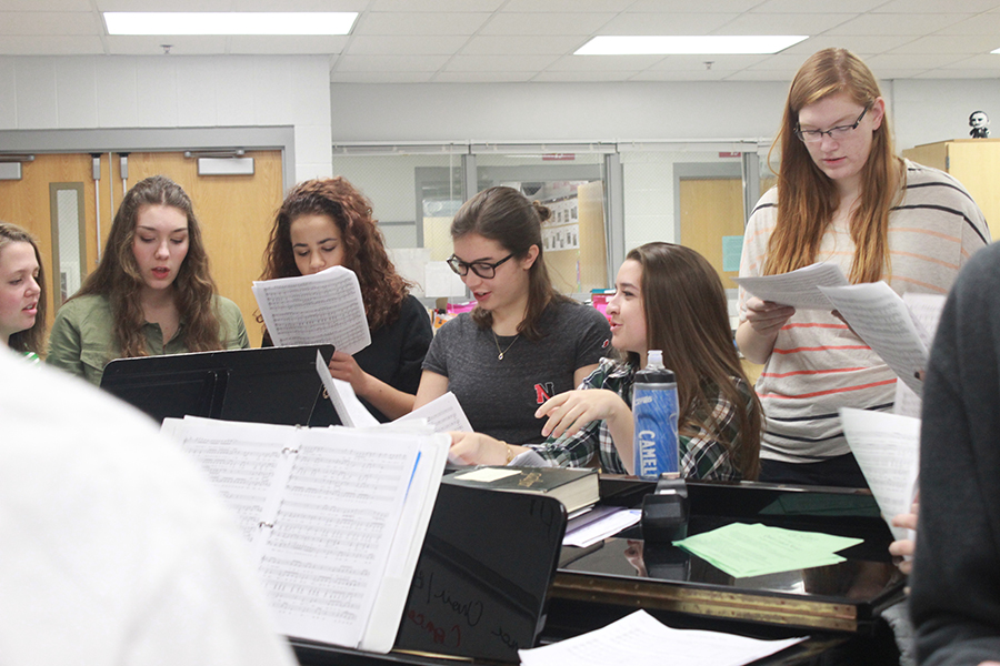 Soprano and alto singers of the Red Knotes rehearse before school with directors Nancy Stockhaus and Adam Petroski. The Red Knotes will be going on a retreat in November to get to know each other better and work better as a choir.