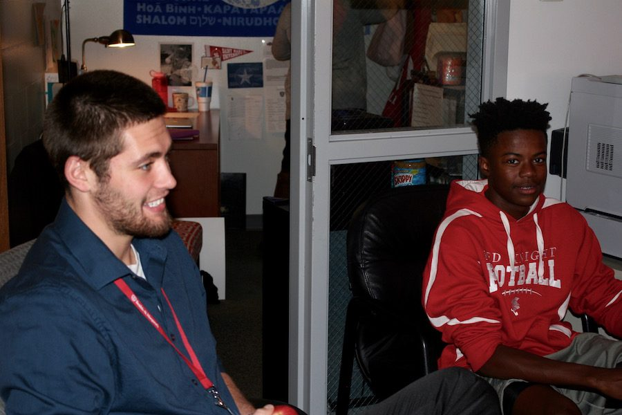 Mr. Sawyer Phillips sits with Freshman Micah Cade at a lunchtime conversations in the Campus Ministry. These conversations provide an opportunity for students to discuss their lives and school events in an environment outside the cafeteria.