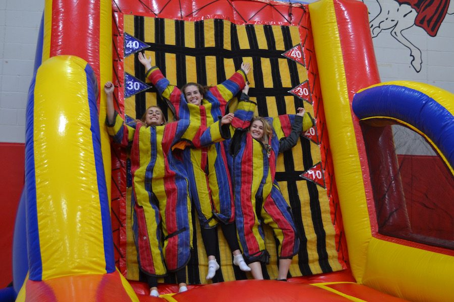 Link Crew Leaders pose stuck to the velcro wall.