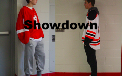 Hockey players from different teams face off.
