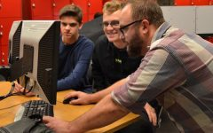 The Engineering 3 students are working to make the best case for the department's new boards.