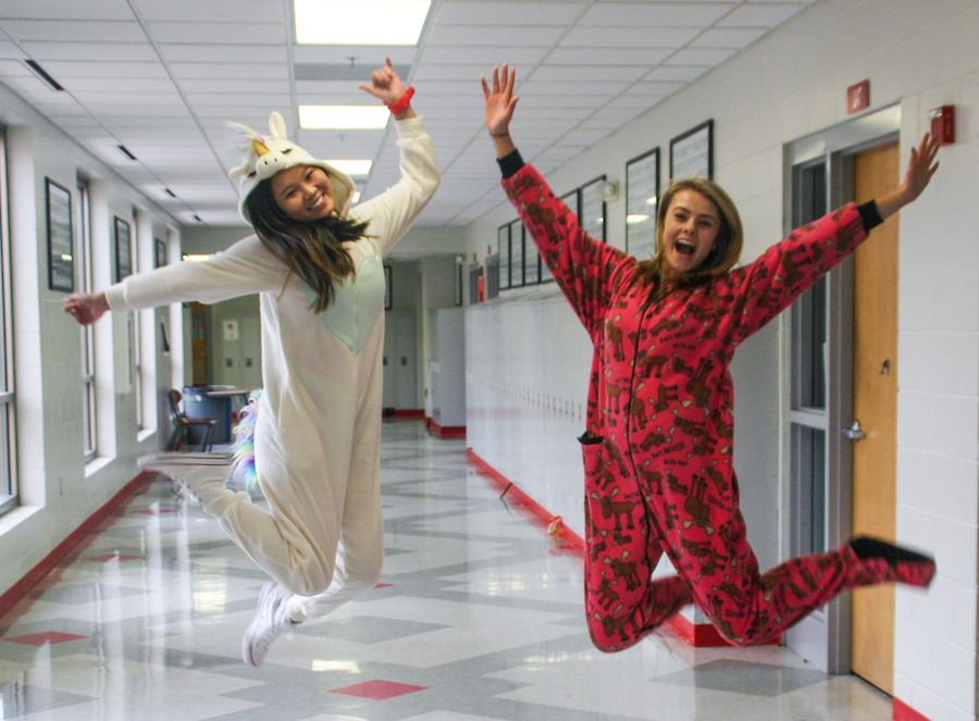 Kathryn Hansen and Natalie Kroll jump for joy in their onesies. Tuesday was declared by the National Catholic Educational Association as a day for