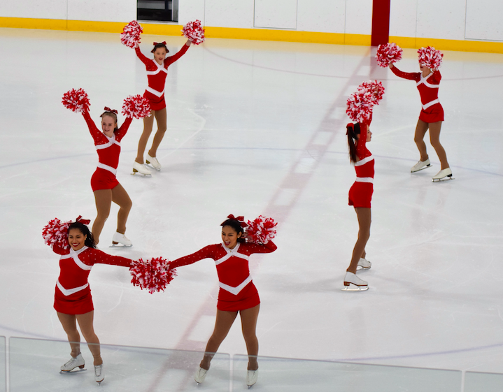 The club performs at hockey games, and the members enjoy the performance.