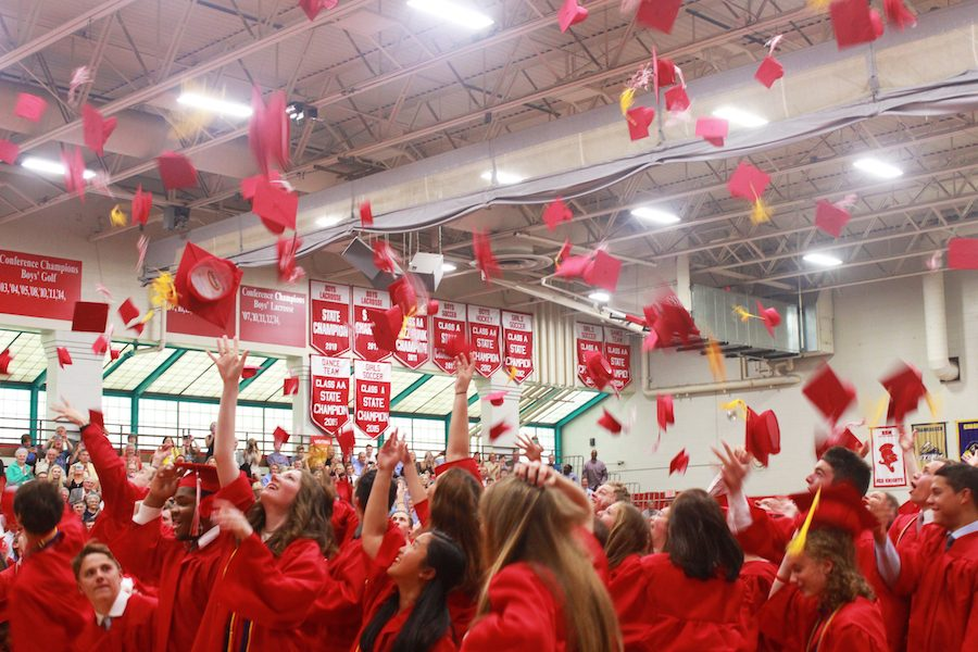 The class of 2016 throw their graduation caps in celebration of their hard work.