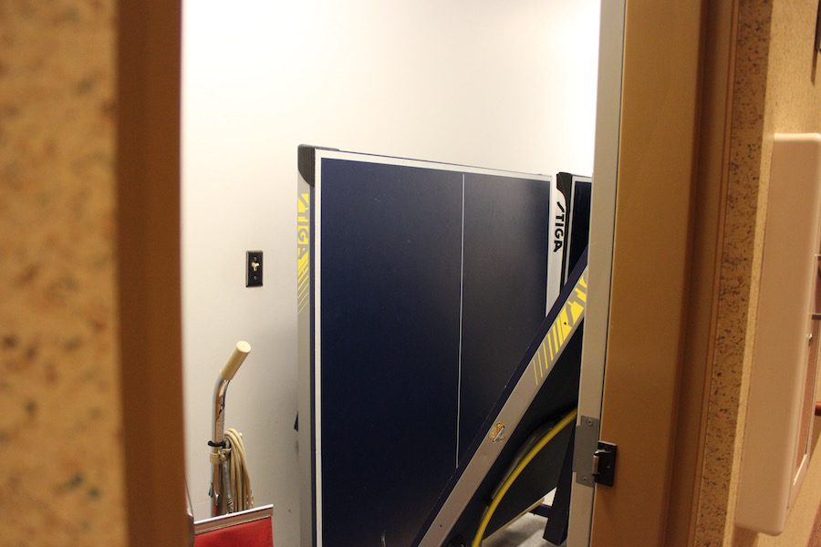 This door leads to a secret entrance from the front of the theater. Currently, it is being used as a makeshift closet for the ping pong tables.