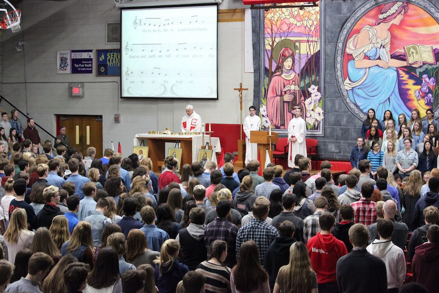 Father Tim celebrates Mass in the Great Hall with the class of 2017 sitting front and center.