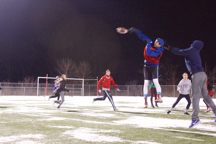 At the snow football tournament, teams of students from different grades competed for bragging rights and Chipotle gift cards. This event took place alongside a movie for those taking breaks or not competing.