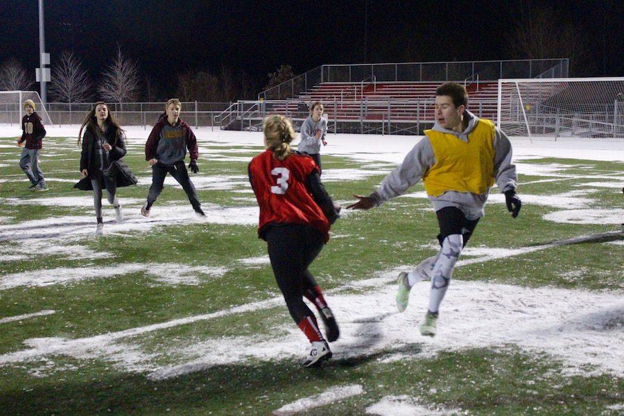 Junior Sam Zimmerman hands the ball off to his teammate, junior Tenley Gage.