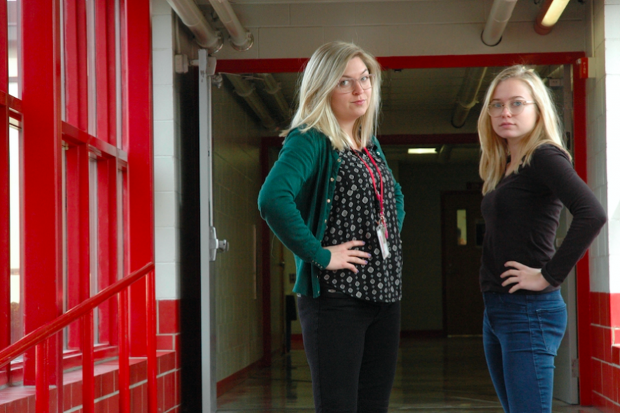 Two blondes with their hands on their hips. If you look closely, you can see that they are not the same person, but in fact Caroline Murphy and Ms. Preus.
