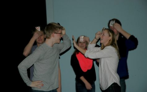Drama department rehearses musical with music written by alum