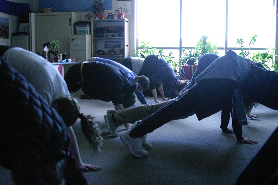 Another+station+involved+yoga+with+French+teacher+Ms.+Frederique+Toft%2C+who+led+students+in+a+sun+salutation.