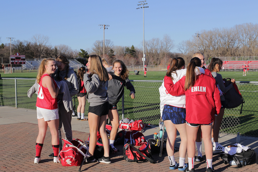 BSM girls' lacrosse players warm up before practice.