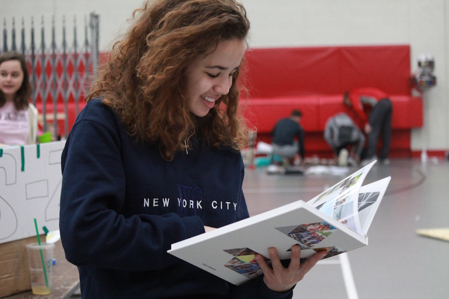 Sophomore Kailyn Pedersen searched for photos of herself and her friends.